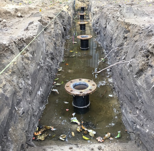 Screw piles installed through high water table